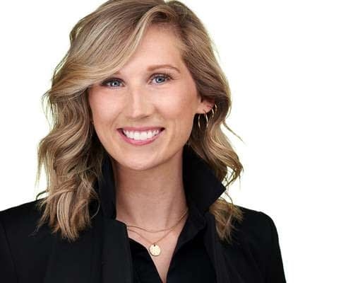 Professional headshot of a women in front of a white background