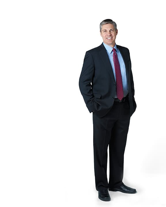 A professional full length image against a white background