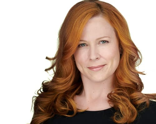 Red headed actress headshot on white background